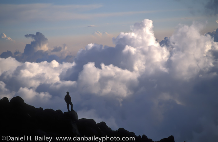 Silhouette of a hiker in the mountains above the clouds, Mexico