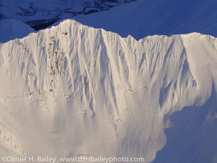 Aerial photo, steep snowy Chugach Mountain face, Alaska