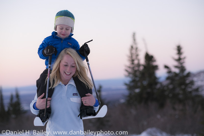 Megan Chelf carrying Brody on her shoulders at sunset, Anchorage foothills.
