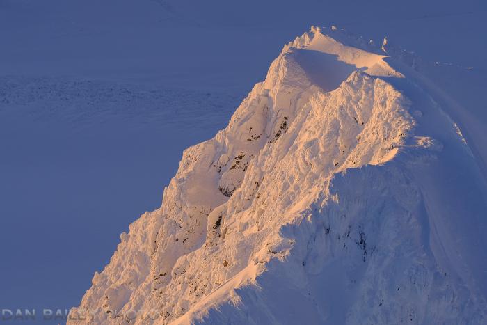 The sunset south flank of Peak 6870. Chugach Mountains, Alaska