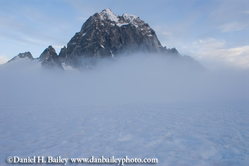 Fog rolling into the Pika Glacier past The Royal Tower, Little Switzerland, Alaska