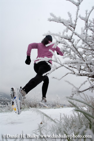 Amy Sebby trail running in the snow.