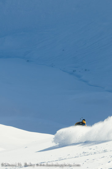 Eric Parsons snowboarding in fresh powder- Hatcher Pass, Talkeetna Mountains, Alaska