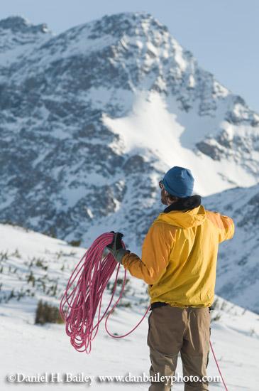Mountaineer coiling ropes, Chugach Mountains, Alaska