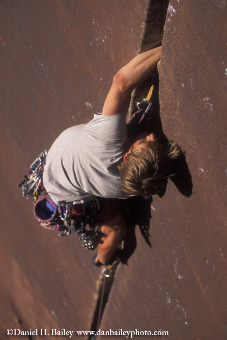Rock climber on Supercrack, Indian Creek, Canyonlands, Utah