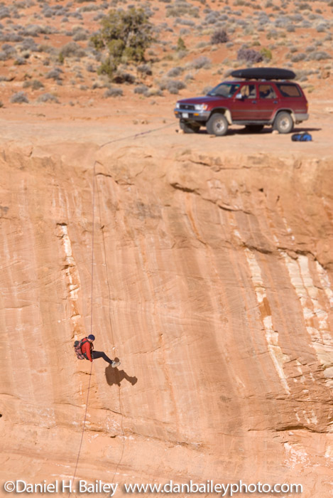 Canyoneering- Rappelling from the bumper of a Toyota Four Runner, Utah