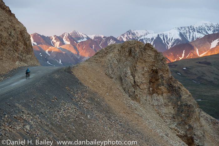 Cycling Polychrome Pass during a midnight sunset