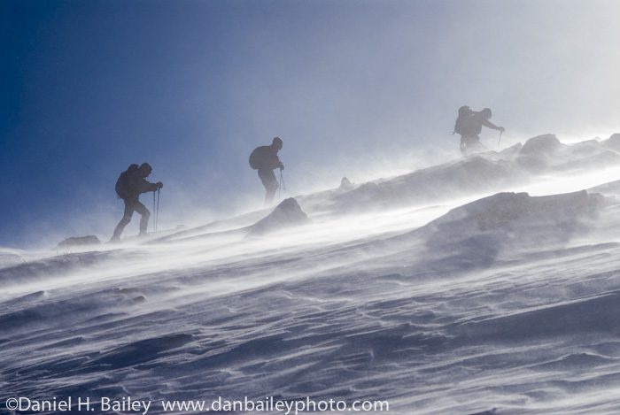 Backcountry skiers skinning up New York Mountain, Colorado