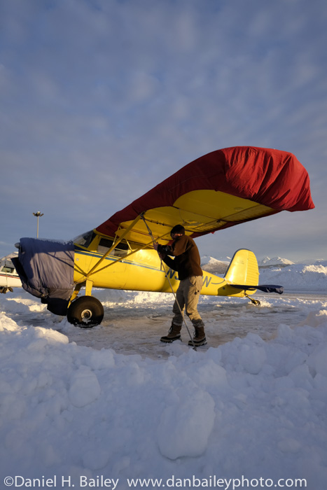 Dan Bailey tying down his 1947 Cessna 120, Merrill Field, Alaska