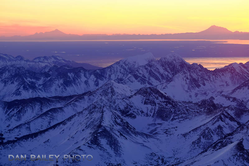 Sunset over Mount Iliamna and Mount Redoubt and the Cook, seen from over the Chugach Mountains