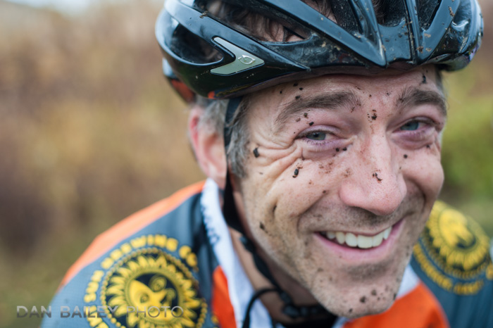 Mud freckled portrait of man wearing a a bike helmet (cyclcross racer) Anchorage, Alaska