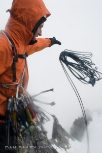 Eric Parsons throwing the rappel ropes into the fog on The Throne, Little Switzerland, Pika Glacier, Alaska