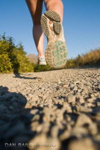Closeup of a woman's feet and shoes trail running, Glen Alps area, Chugach Mountains, near Anchorage, Alaska